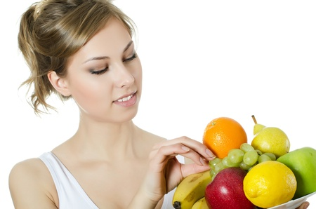 The beautiful girl with fruit and vegetables Stock Photo - 17560467