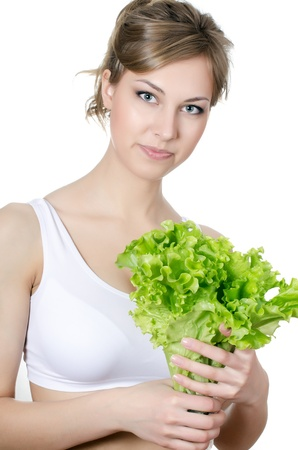 The beautiful girl with green salad isolated Stock Photo - 17574192