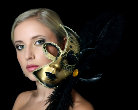 venice mask: The beautiful girl in a carnival mask Stock Photo