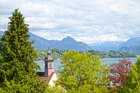 over the hill: Looking over the church on Lake Lucerne in Switzerland. Stock Photo