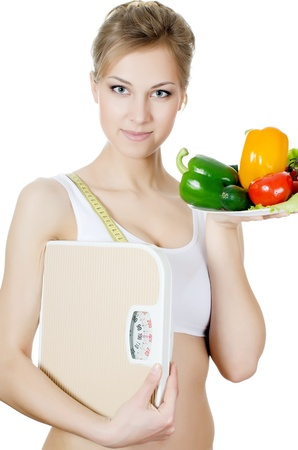 The beautiful girl with plate with vegetables photo