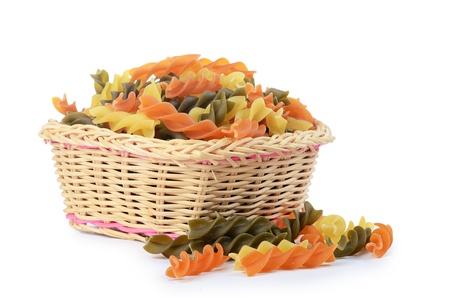 Raw colored pasta fusilli isolated on white photo
