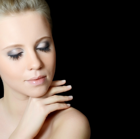 The young beautiful girl with Evening make-up photo