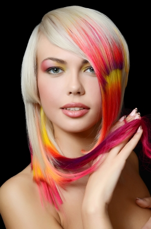 Woman with bright make-up and multi-coloured strand in hair