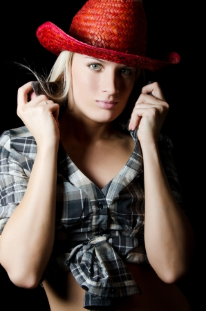 The beautiful girl in a cowboys hat photo