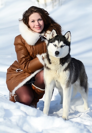 Woman with dog Husky in the winter photo