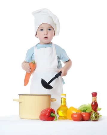 The little boy in hat of cook Stockfoto