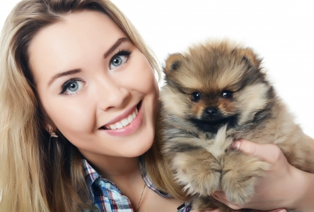 The beautiful girl with puppy spitz isolated photo