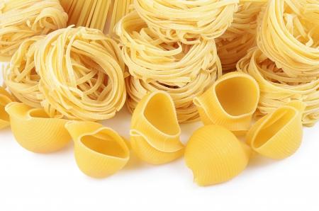 raw gold: Italian pasta tagliatelle nest isolated on white