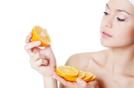 exfoliate: The beautiful woman with a orange  isolated