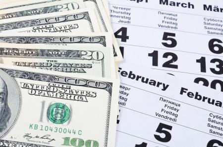 Banknotes of dollars on calendar sheets close-up Stock Photo - 18441860