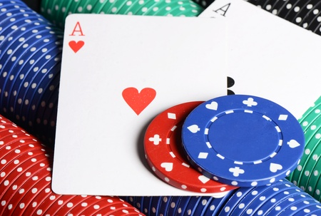 Two ases and casino chips close up Stock Photo - 18443814