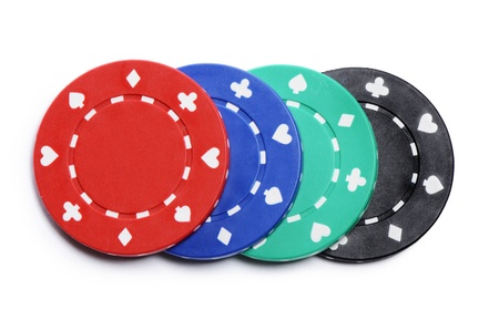 Four casino chips isolated on white background photo