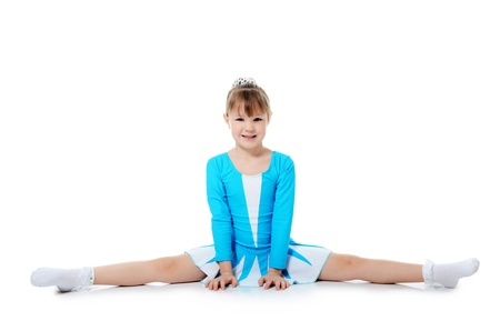 The little girl the gymnast does exercise photo