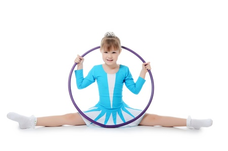 acrobatic: Little girl gymnast does exercise with hoop Stock Photo