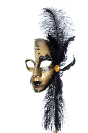 Gold a carnival mask with black feathers Stock Photo