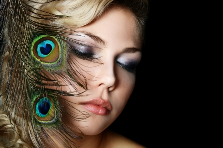 The beautiful woman with feathers of peacock