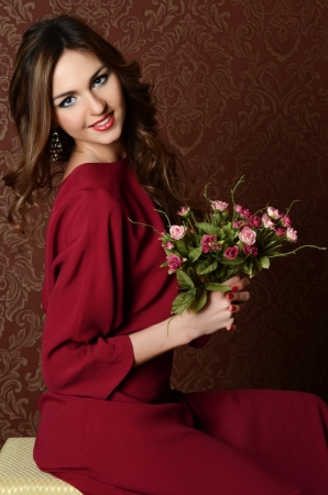 Elegant sensual young woman in claret dress Stock Photo - 18558861