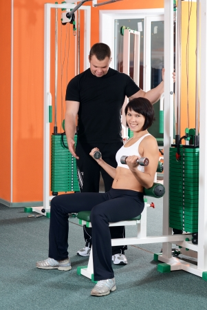 Woman on training apparatus in sports club Stock Photo - 18558865