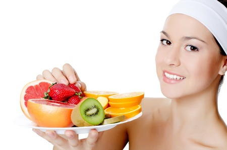 The beautiful woman with a fruit isolated photo