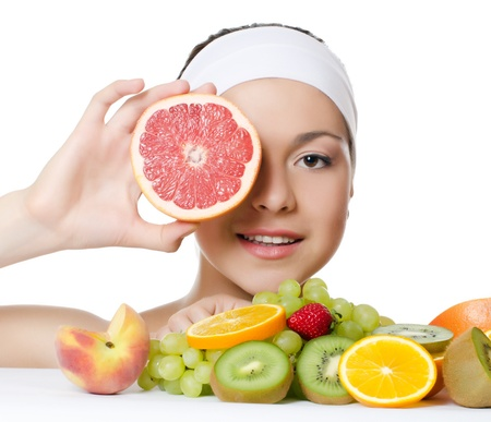 summer diet: The beautiful woman with a fruit isolated Stock Photo