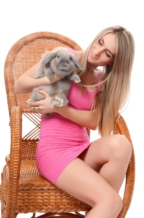 fluffy ears: The beautiful woman with a grey rabbit isolated
