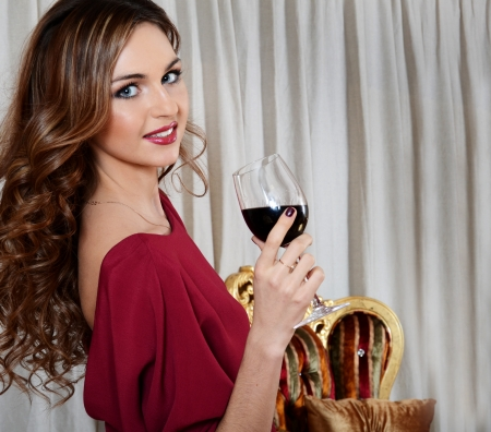 The elegant woman with wine glass at smart restaurant photo