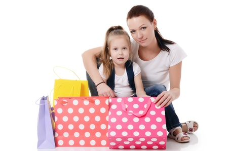 Mom and daughter with a lot packages with shopping photo
