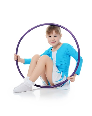 Little girl gymnast does exercise with hoop Stock Photo