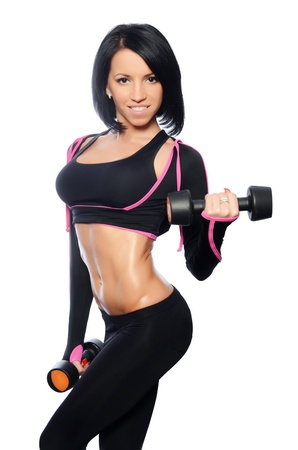 The woman with beautiful body with dumbbells Standard-Bild