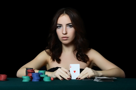Beautiful woman with casino chips a black photo