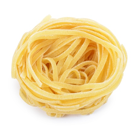 Italian pasta tagliatelle nest isolated on white