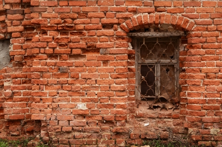 Window of the old brick house close up photo