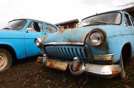 junk car: The old rusty car close up Stock Photo