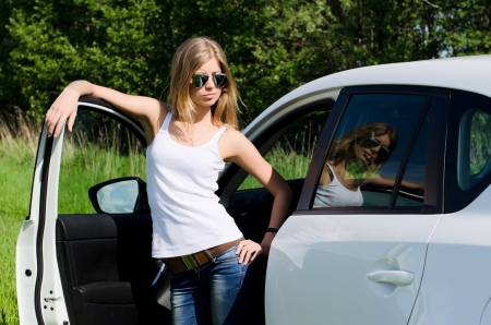 sexy hands: Beautiful girl stands near to white car Stock Photo