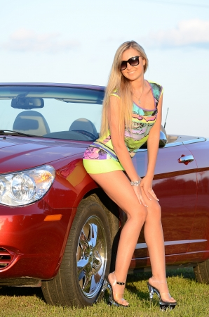 Beautiful girl stands near to white car Stock Photo