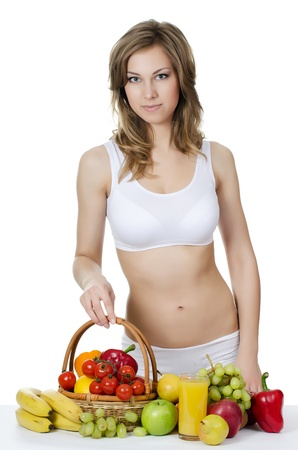 The beautiful girl with fruit and vegetables Stock Photo - 20674547