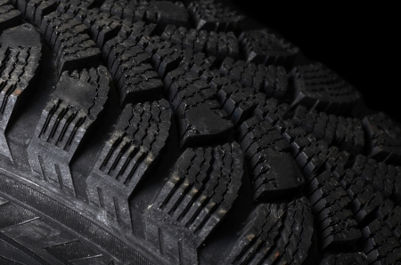The automobile tire on a black background photo