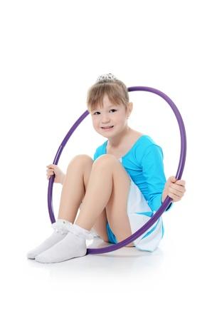 gymnastics girl: Little girl gymnast does exercise with hoop Stock Photo