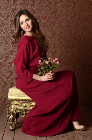 Elegant sensual young woman in claret dress photo