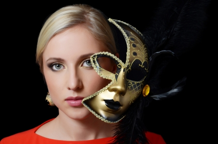 The beautiful girl in a carnival mask photo