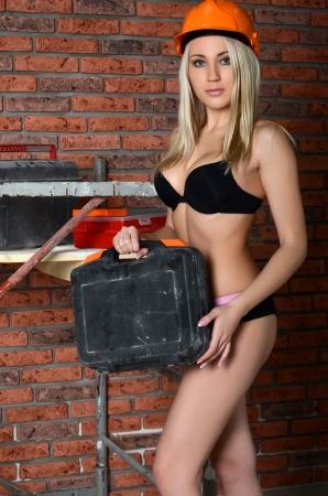 sexy construction worker: The woman in underwear in a helmet