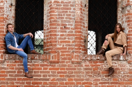 Young enamoured pair at a brick wall photo