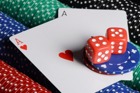 Double aces with big stack and dice photo