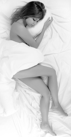 The beautiful woman sleeps in a bed photo