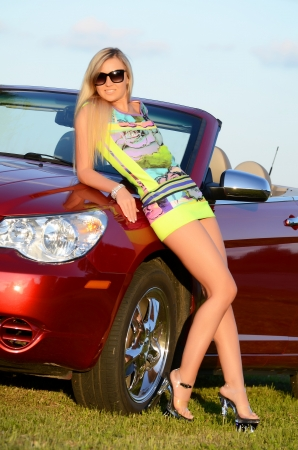 sexy woman car: Beautiful girl stands near to red car