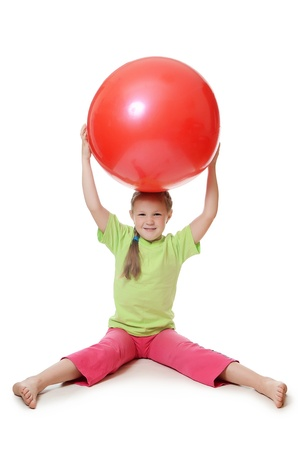 The little girl with a gymnastic ball photo