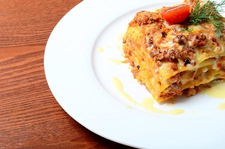 The Italian lasagna on a white  plate photo