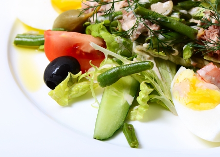 The salad from fresh vegetables with veal photo