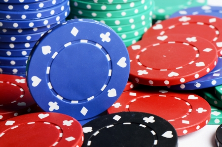 gambling counter: Casino chips as a background close up